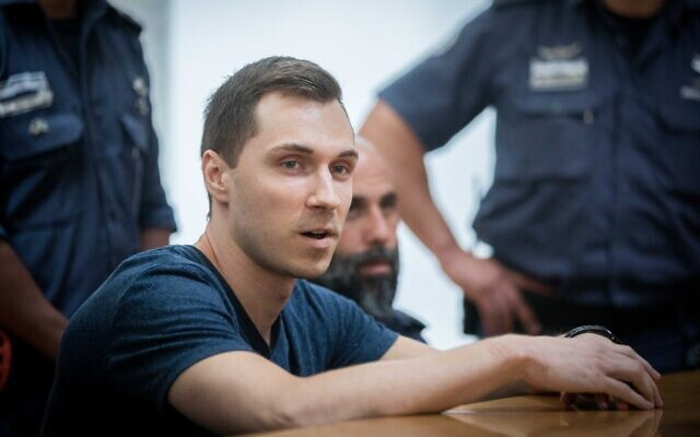Alexsey Burkov, a Russian hacker wanted by the United States, attends an appeals hearing against his pending extradition, at the High Court of Justice in Jerusalem, November 3, 2019. (Yonatan Sindel/Flash90)