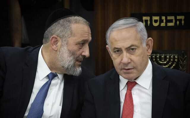 Shas party chairman and Minister of Interior Affairs Aryeh Deri (L) and Prime Minister Benjamin Netanyahu at a ceremony marking the six year anniversary of death of Rabbi Ovadia Yosef, at the Knesset, November 4, 2019. (Hadas Parush/Flash90)