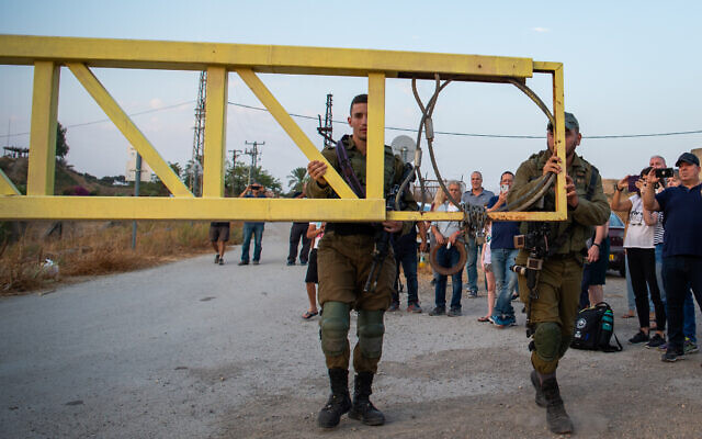 "Israeli soldiers close the gate leading to the ""Isle of Peace"" at Naharayim on November 9, 2019.  (Basel Awidat/Flash90)"