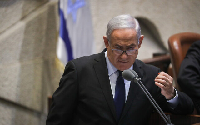 Prime Minister Benjamin Netanyahu speaks during a memorial ceremony marking 24 years since the assassination of former prime minister Yitzhak Rabin, in the Knesset, on November 10, 2019. (Yonatan Sindel/FLASH90)