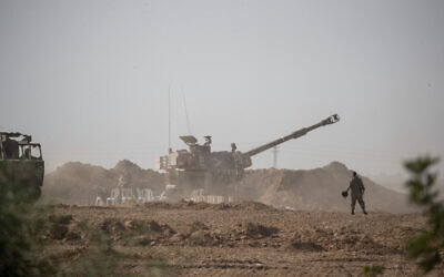 Israeli soldiers and artillery at a staging area in southern Israel, near the border with the Gaza Strip on November 13, 2019. (Yonatan Sindel/Flash90)