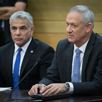 Blue and White's Benny Gantz (right) and Yair Lapid during a faction meeting at the Knesset on November 18, 2019. (Hadas Parush/Flash90)