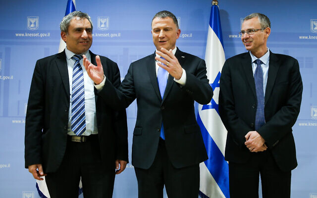 Knesset Speaker Yuli Edelstein (C) meets with Likud ministers and coalition negotiators Zeev Elkin (L) and Yariv Levin (R) on November 27, 2019. (Flash90)