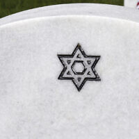An illustrative photo of a Jewish grave (Robert Alexander/Getty Images via JTA)