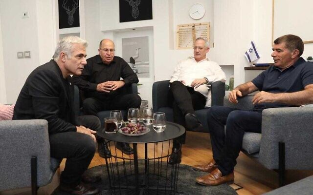 Blue and White party leaders (from left) Yair Lapid, Moshe Ya'alon, Benny Gantz and Gabi Ashkenazi meet to discuss ongoing coalition negotiations on November 17, 2019. (Courtesy/Elad Malka)