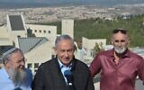 (From L-R) Gush Eztion Regional Council chairman Shlomo Ne'eman, Prime Minister Benjamin Netanyahu and Yesh Council chairman David Elhayani in front of a Gush Etzion lookout point in the West Bank on November 19, 2019. (Haim Zach/GPO)