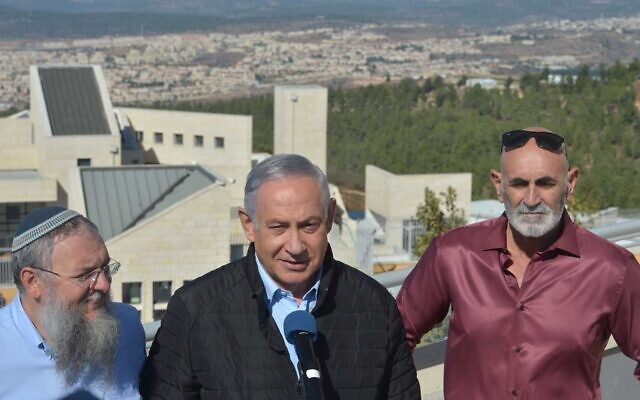 (From L-R) Gush Etzion Regional Council chairman Shlomo Ne'eman, Prime Minister Benjamin Netanyahu and Yesha Council chairman David Elhayani in front of a Gush Etzion lookout point in the West Bank on November 19, 2019. (Haim Zach/GPO)