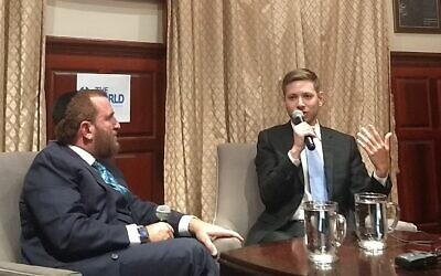 Yair Netanyahu, Israeli Prime Minister Benjamin Netanyahu's son, speaks with Rabbi Shmuley Boteach on Nov. 6, 2019 in New York City. (Ben Sales / JTA)