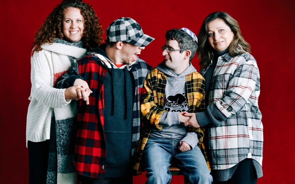 Left to right: Sabrina Barell, Daniel Propper, Danny Laszlo, and Kathy Laszlo in photo for the Roots Nice Together 2019 Holiday Campaign. (Barbara Stoneham/courtesy of Roots)