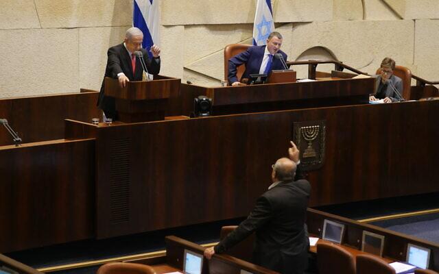 Joint List MK Ahmad Tibi (bottom) verbally clashing with Prime Minister Benjamin Netanyahu (L) during a Knesset plenum debate on Gaza, November 13, 2019. (Adina Wellman/Knesset spokesperson's office)
