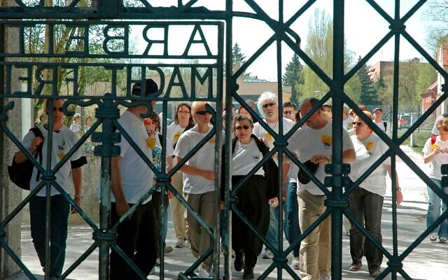 Holocaust survivor Rose Price, center, is the first to approach the gates of the Dachau concentration camp on the first March of Life, in 2007. (Courtesy)