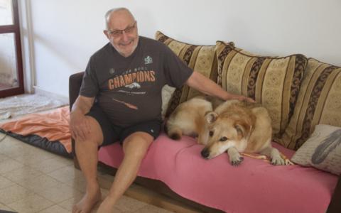 Don Salman in his home in Kibbutz Nahal Oz on November 14, 2019. (Jacob Magid/Times of Israel)