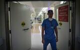 Illustrative: A doctor leaves the operations department in Hadassah Ein Karem Hospital in Jerusalem, September 3, 2017. (Hadas Parush/Flash90)