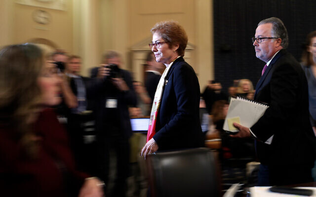 Former US Ambassador to Ukraine Marie Yovanovitch leaves after testifying to the House Intelligence Committee on Capitol Hill in Washington, November 15, 2019, during the second public impeachment hearing of US President Donald Trump. (AP Photo/Andrew Harnik)