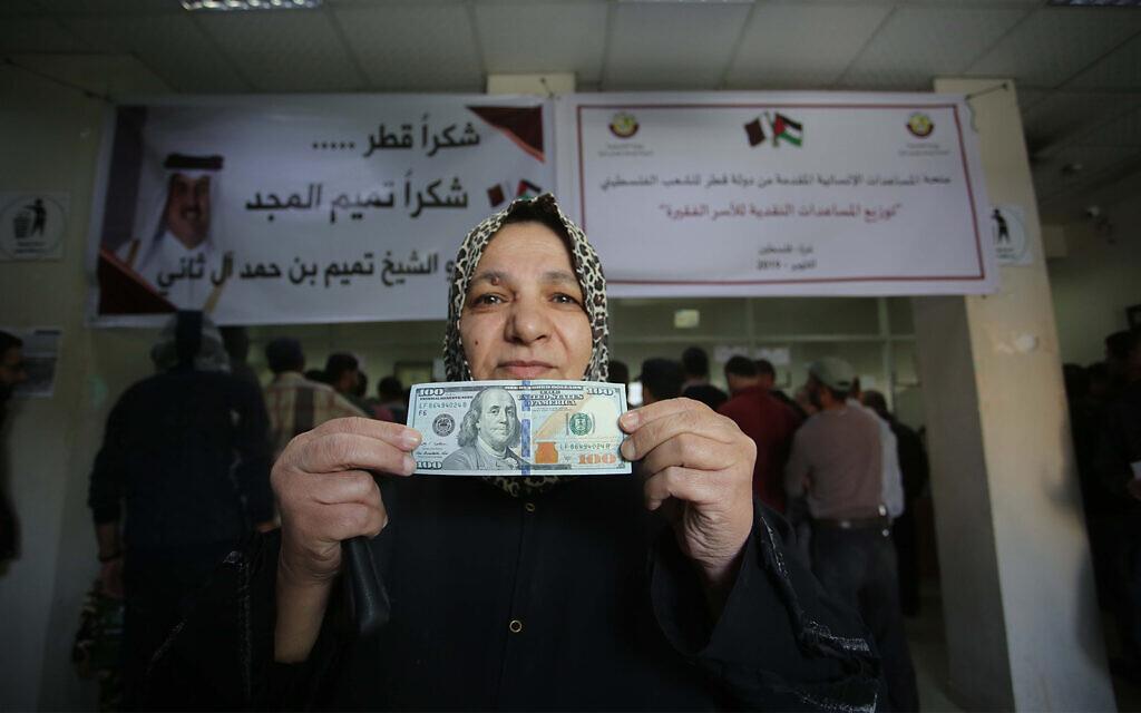 Banks begin handing out Qatari $100 bills to needy Gazans
