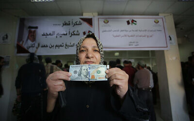 Palestinians receive financial aid from Qatar at a post office in Gaza City, November 27, 2019. (Hassan Jedi/Flash90)