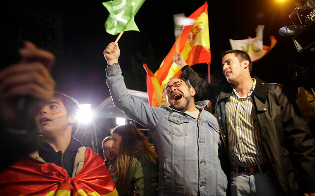 Supporters of Spain's far-right Vox party cheer after the announcement of the general election first results, in Madrid, Spain, November 10, 2019. (AP Photo/Andrea Comas)