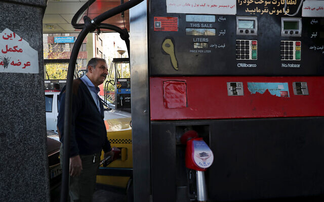 A taxi driver fills his car at a gas station in Tehran, Iran, November 15, 2019. Authorities have imposed rationing and increased the prices of fuel. (AP Photo/Vahid Salemi)