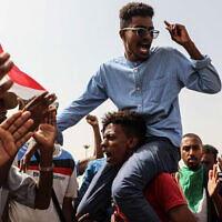 People take part in a protest in Khartoum, Sudan, July 18, 2019. (AP Photo/Mahmoud Hjaj)