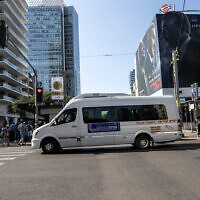 A public bus operated on Shabbat drives through Tel Aviv, November 23, 2019. (AP Photo/Tsafrir Abayov)