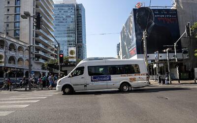 A public bus operated on Shabbat drives through Tel Aviv, November 23, 2019. (AP Photo/Tsafrir Abayov)