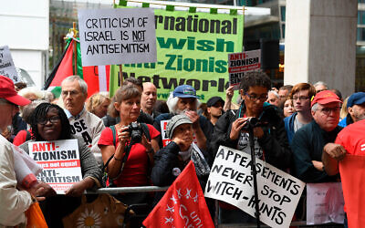 Illustrative: Anti-Israel activists react outside a meeting of the Labour National Executive Committee in London, September 4, 2018. (Stefan Rousseau/PA via AP)