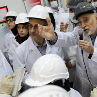 In this photo released on Monday, Nov. 4, 2019 by the Atomic Energy Organization of Iran, Ali Akbar Salehi, head of the organization, speaks with media while visiting Natanz enrichment facility, in central Iran. (Atomic Energy Organization of Iran via AP)