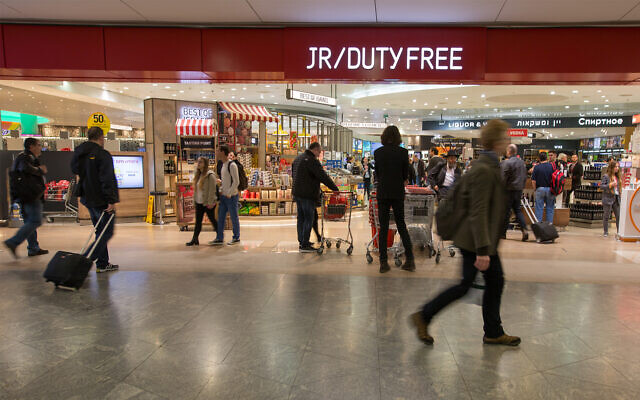 Illustrative: Travelers walk by a duty free shop at Ben-Gurion International Airport, March 4, 2016. (Noam Revkin Fenton/FLASH90)