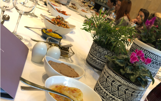An array of salads and dishes at the Mamilla Shabbat experience, part of Open Restaurants Jerusalem on November 20, 2019 (Jessica Steinberg/Times of Israel)