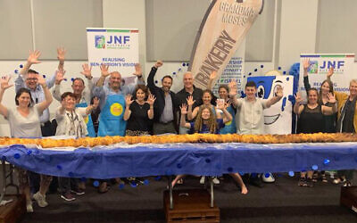 A kosher bakery in Sydney, Australia, breaks the Guinness world record for longest challah. (The Australian Jewish News/Facebook via JTA)