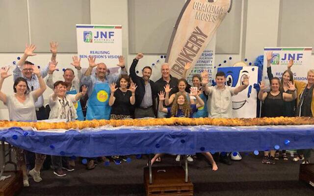 A kosher bakery in Sydney, Australia, breaks the Guinness world record for longest challah. (The Australian Jewish News/Facebook via JTA)