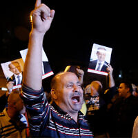 Supporters of Lebanese President Michel Aoun during a protest near the presidential palace in the Beirut suburb of Baabda, Lebanon, November 26, 2019. (AP Photo/Bilal Hussein)