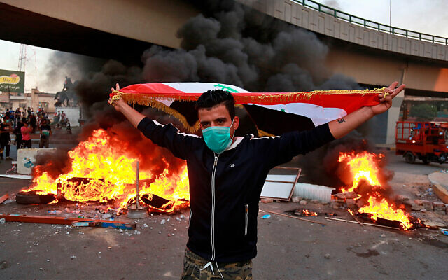 An anti-government protester near the prime minister's office and state-run TV in Baghdad, Iraq, November 4, 2019. (AP Photo/Khalid Mohammed)