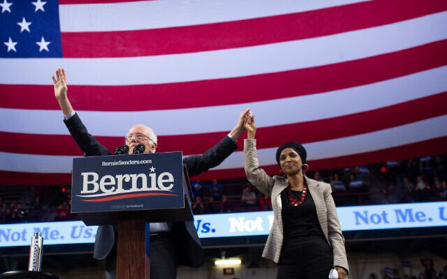 Democratic presidential hopeful Vermont Senator Bernie Sanders and Representative Ilhan Omar of Minnesota onstage at a campaign rally in Minneapolis, Minnesota, November 3, 2019. (Kerem Yucel/AFP)