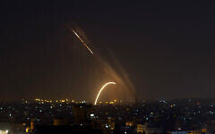 Illustrative: Rockets are launched from the Gaza Strip toward Israel, November 13, 2019. (AP Photo/Khalil Hamra)