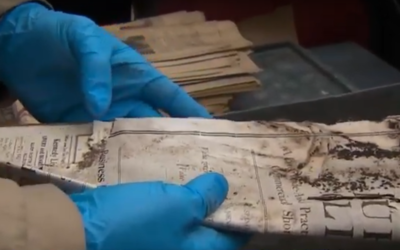 Items are removed from a time capsule from 1906 found in the cornerstone of the Tree of Life synagogue's former location in Pittsburgh, November 4, 2019. (Screenshot: YouTube)