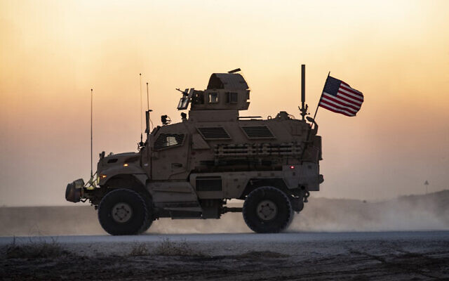 A US military vehicle, part of a convoy, drives near the town of Tal Tamr in the northeastern Syrian Hasakeh province on the border with Turkey, November 10, 2019. (Delil Souleiman/AFP)