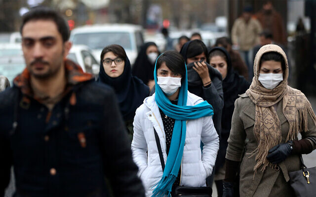 Iranian women wear masks for protection against air pollution in Tehran, Iran, December 20, 2015. (AP Photo/Vahid Salemi)