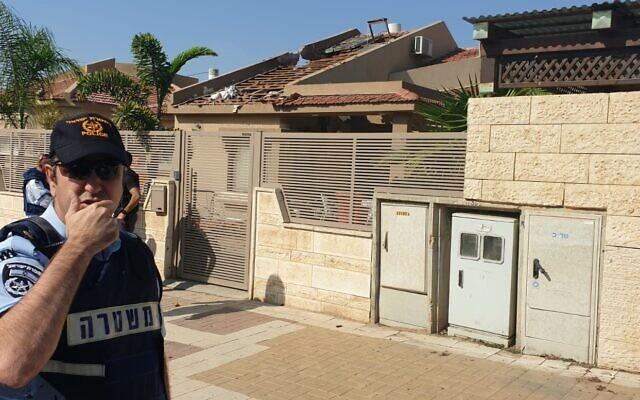 Police officers arrive at the scene of a house in the southern town of Netivot that was struck by a rocket fired from the Gaza Strip on November 12, 2019. (Israel Police)