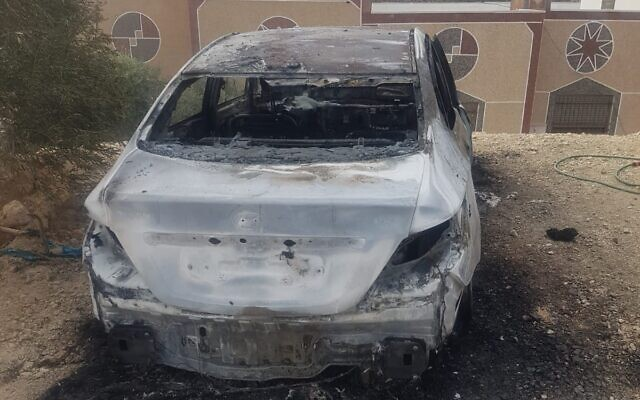A car torched in a suspected hate crime in seen in the northern West Bank village of Qabalan on November 22, 2019. (Qabalan Municipality)