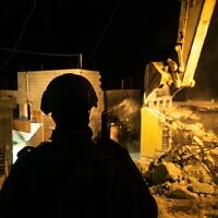 Israeli troops demolish the home of a Palestinian man suspected of murdering a yeshiva student in a terror attack this summer, in the southern West Bank village of Beit Kahil on November 28, 2019. (Israel Defense Forces)