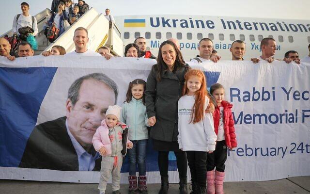 IFCJ President Yael Eckstein greets some of 243 immigrants from Ukraine on the 'Rabbi Yechiel Eckstein Memorial Freedom Flight' (Noam Moshkowitz/IFCJ via JTA)