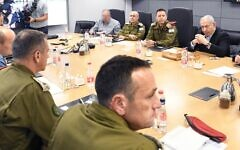 Prime Minister Benjamin Netanyahu, top right, in security consultations with other defense brass on November 13, 2019. (Amos Ben Gershon/GPO)
