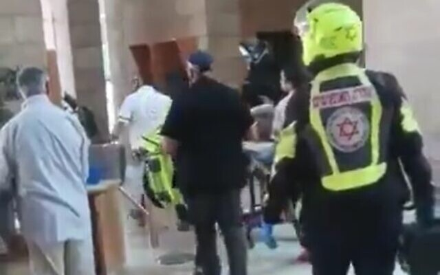 Medics evacuate a man who lit himself on fire in a Beersheba court on November 10, 2019 (screen capture via Twitter)