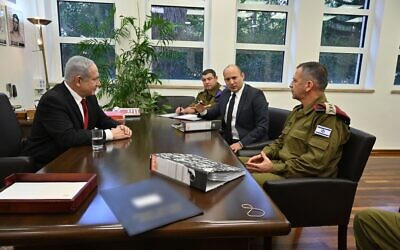 New Defense Minister Naftali Bennett meets with Prime Minister Benjamin Netanyahu (L),  IDF Chief of Staff Aviv Kohavi (R) and Brig. Gen. Ofer Winter, the military secretary to the defense minister, on November 12, 2019. (Ariel Hermoni/Defense Ministry)