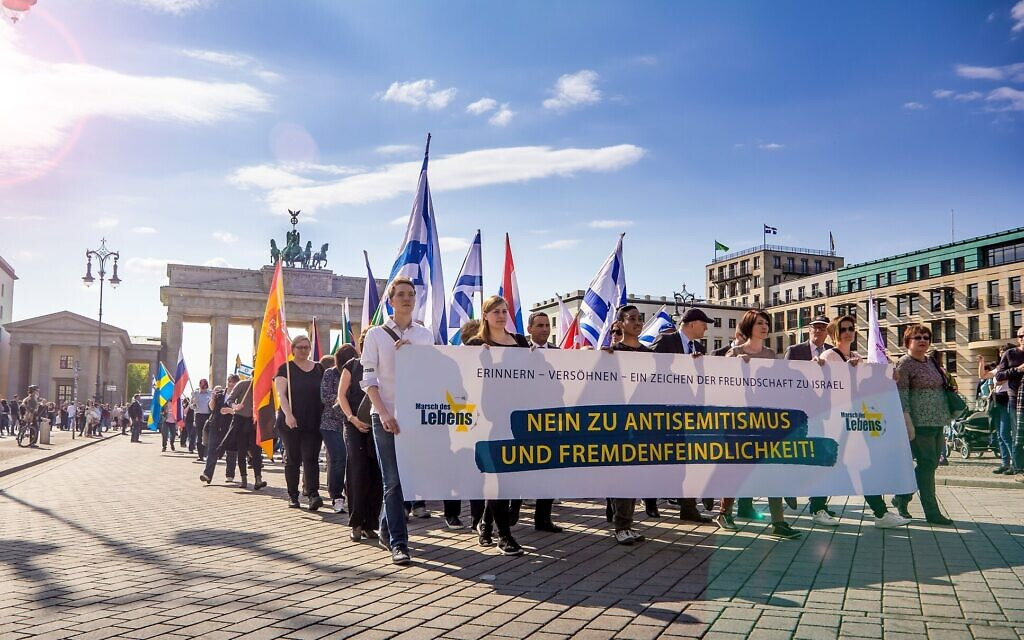 Leaders march with a banner saying 'No to anti-Semitism' in the Berlin March of Life. (Courtesy)