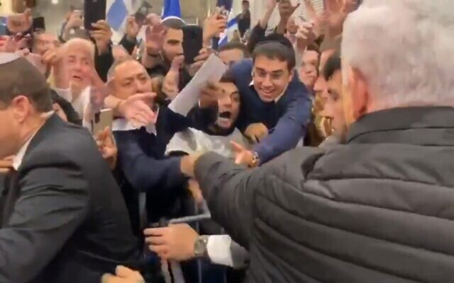 Prime Minister Benjamin Netanyahu shaking hands with supporters outside his official residence in Jerusalem on November 23, 2019. (screen capture: Twitter)