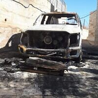 A car found torched in the West Bank village of Taybeh, November 29, 2019. (Taybeh council)