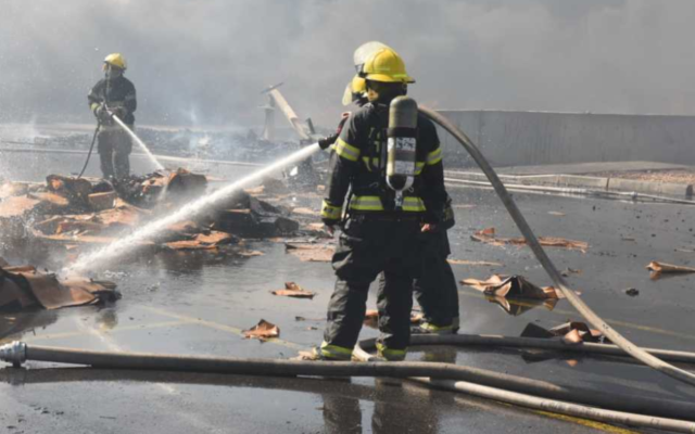 Firefighters battle a blaze at an industrial zone near the southern Bedouin city of Rahat on November 18, 2019. (Fire and Rescue Services)