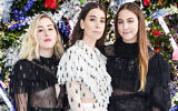 The Haim sisters, from left, Alana, Danielle and Este, of the group Haim at Rodarte's fashion week show in San Marino, California, February 5, 2019. (Presley Ann/Patrick McMullan via Getty Images/via JTA)